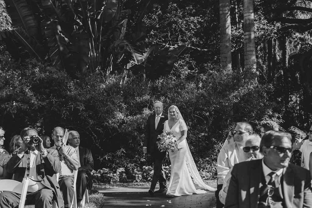 Black and White Bride and Father Walking Down the Wedding Ceremony Aisle Photo