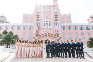 Modern Tropical Bride, Groom, Groomsmen and Bridesmaids in Mix and Match Blush Pink Dresses Wedding Party Portrait | Waterfront Historic St. Pete Beach Wedding Venue The Don Cesar | St. Pete Wedding Planner Parties A'La Carte