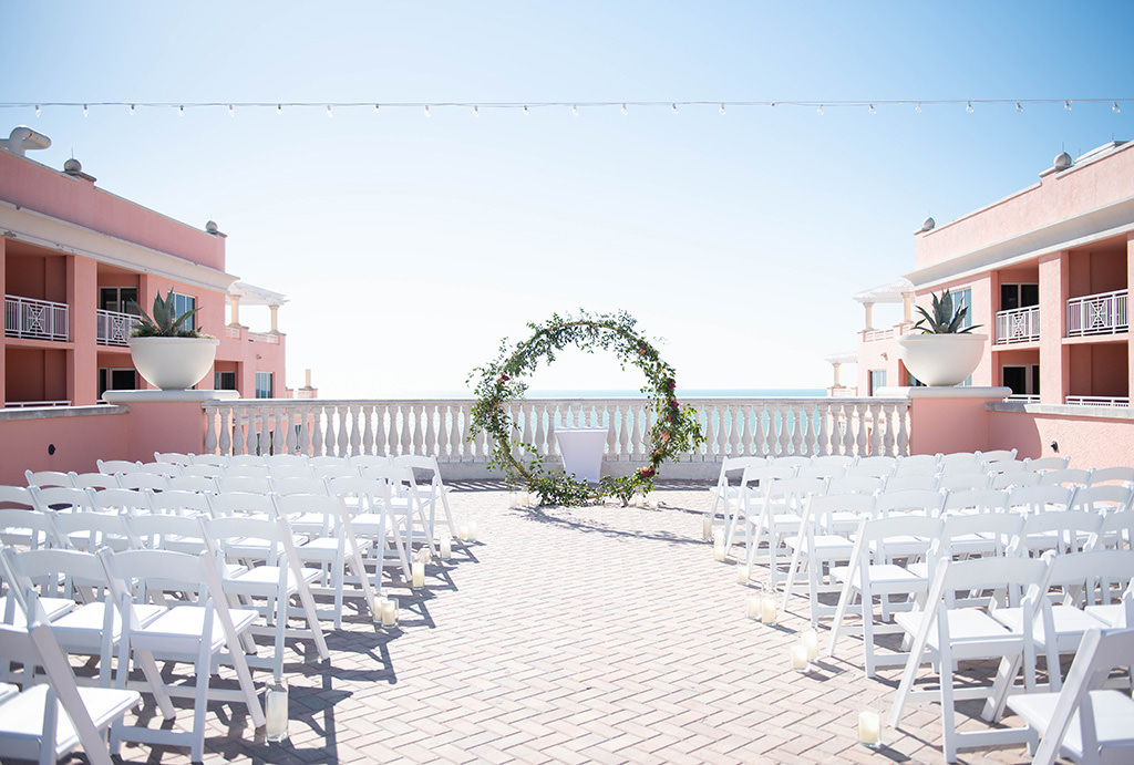 INSTAGRAM WEEKLY ROUND UP Elegant Wedding Ceremony Decor, White Folding Chairs, Circular Arch with Greenery and Floral Arrangements | Wedding Venue Hyatt Regency Clearwater Beach | Wedding and Event Rentals Gabro Event Services