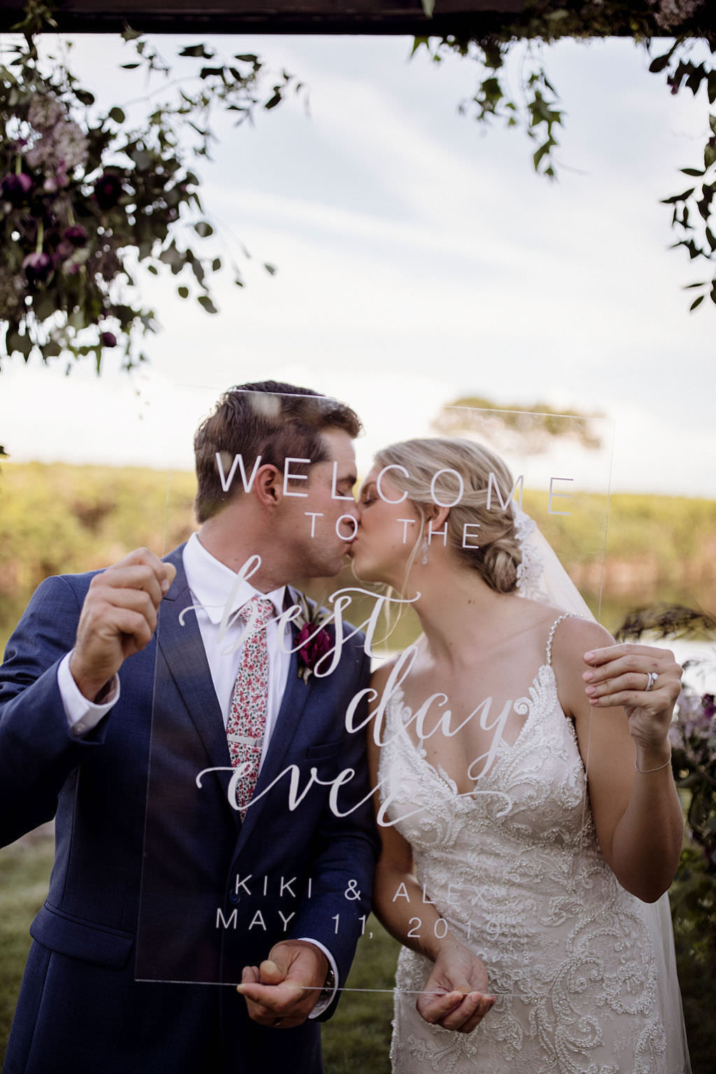 Unique Bride and Groom Intimate Kissing Wedding Portrait Behind Clear Acrylic Custom Welcome Sign