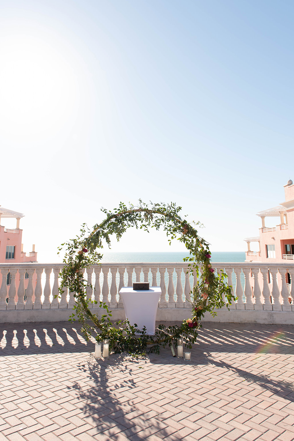 INSTAGRAM WEEKLY ROUND UP Elegant Waterfront Rooftop Wedding Ceremony Decor, White Folding Chairs, Circular Arch with Greenery and Floral Arrangements | Clearwater Beach Rooftop Wedding Venue Hyatt Regency Clearwater Beach | Wedding and Event Rentals Gabro Event Services