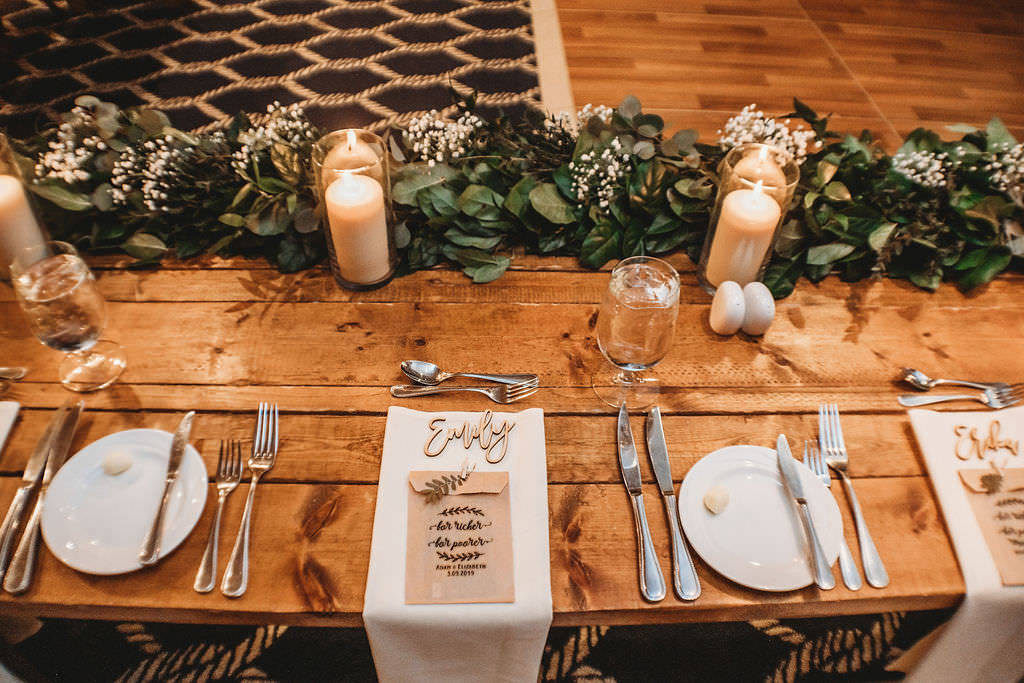 Clearwater Beach Farm-table Wedding Reception Place Setting with Greenery and Candles| Clearwater Beach Wedding Venue Carlouel Yacht Club