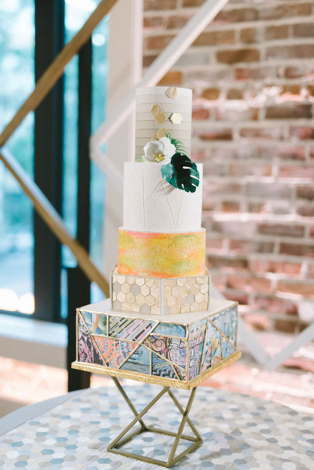 Unique Modern Five Tier Wedding Cake with St. Pete Mural Bottom Tier, Geometric Gold Tier, Bright Pink and Yellow Tier, White Tier and White and Ombre Taupe Top Tier Wedding Cake | Tampa Bay Wedding Photographer Kera Photography | St. Pete Wedding Baker The Artistic Whisk