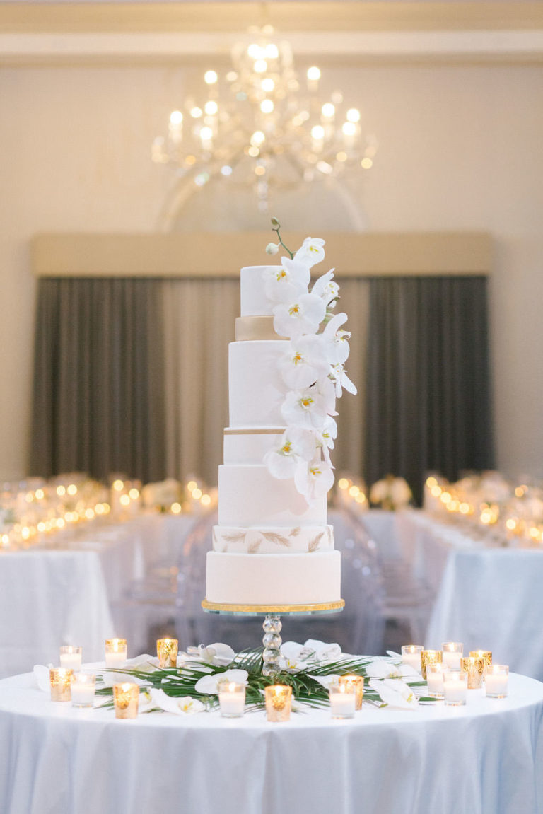 Elegant Classic Modern Seven Tier White and Gold Wedding Cake with Cascading White Real Orchid Flowers | Tampa Bay Wedding Baker The Artistic Whisk | Wedding Florist Bruce Wayne Florals | Wedding Rentals Kate Ryan Event Rentals