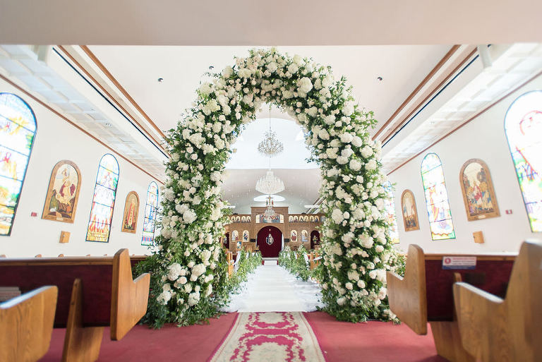 Stunning Classic Elegant White Ivory and Greenery Wedding Ceremony Floral Arch Entrance | Tampa Bay Wedding Photographer Kristen Marie Photography | Traditional Wedding Ceremony Venue St. George Coptic Orthodox Church | Clearwater Beach Wedding Florist Gabro Event Services | Wedding Day of Coordinator Special Moments Event Planning