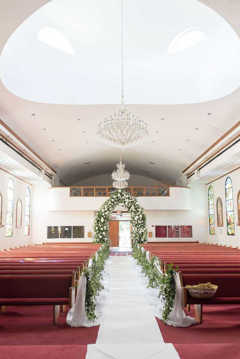 Stunning Classic Elegant White Ivory and Greenery Wedding Ceremony Floral Arch Entrance | Tampa Bay Wedding Photographer Kristen Marie Photography | Traditional Wedding Ceremony Venue St. George Coptic Orthodox Church | Clearwater Wedding Florist Gabro Event Services