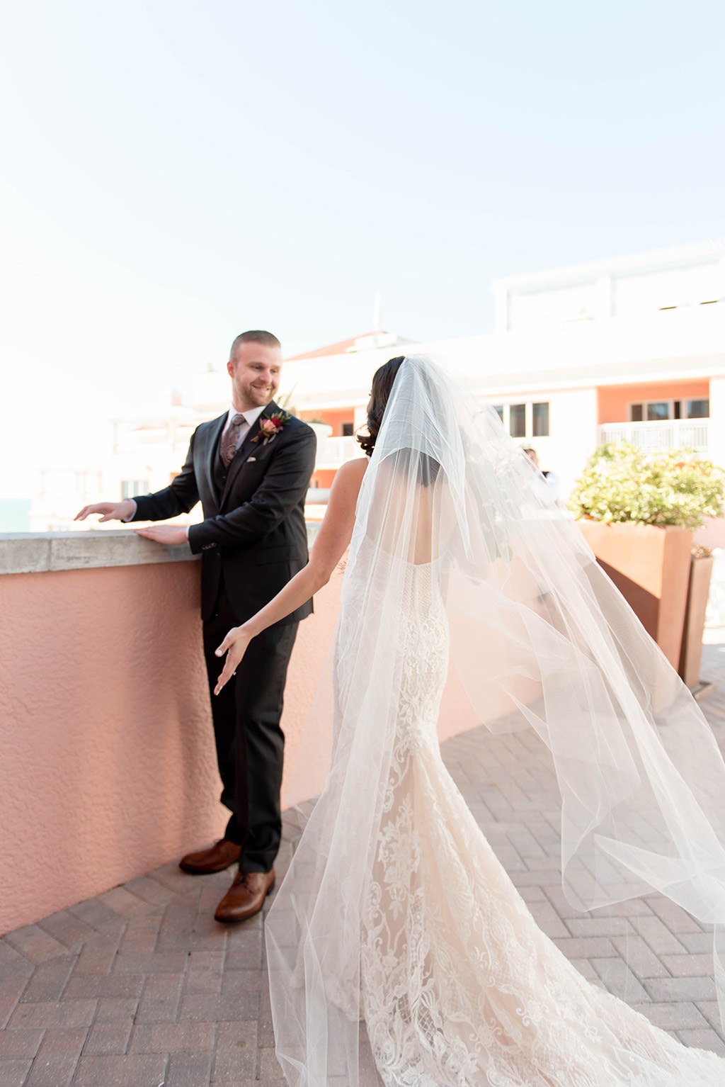 Florida Bride and Groom First Look Wedding Portrait on Waterfront Rooftop Hotel Wedding Venue Hyatt Regency Clearwater Beach | Tampa Bay Wedding Dress Shop Isabel O'Neil