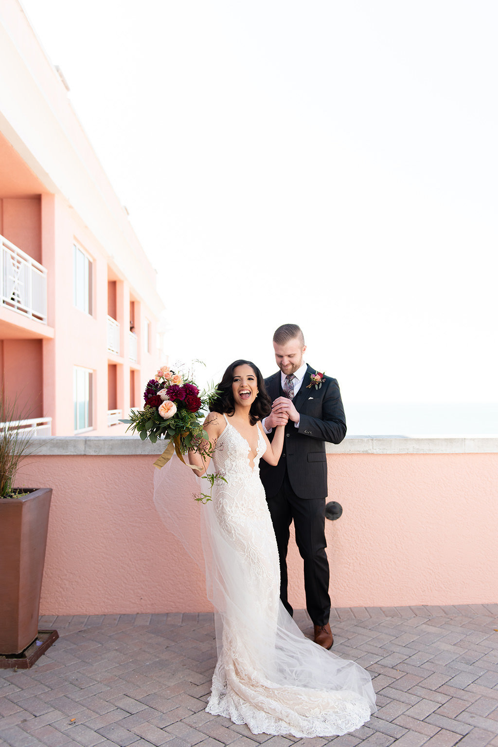 Florida Bride and Groom First Look Wedding Portrait on Waterfront Rooftop Hotel Wedding Venue Hyatt Regency Clearwater Beach | Tampa Bay Wedding Dress Shop Isabel O'Neil Bridal Collection | Galia Lahav Wedding Dress