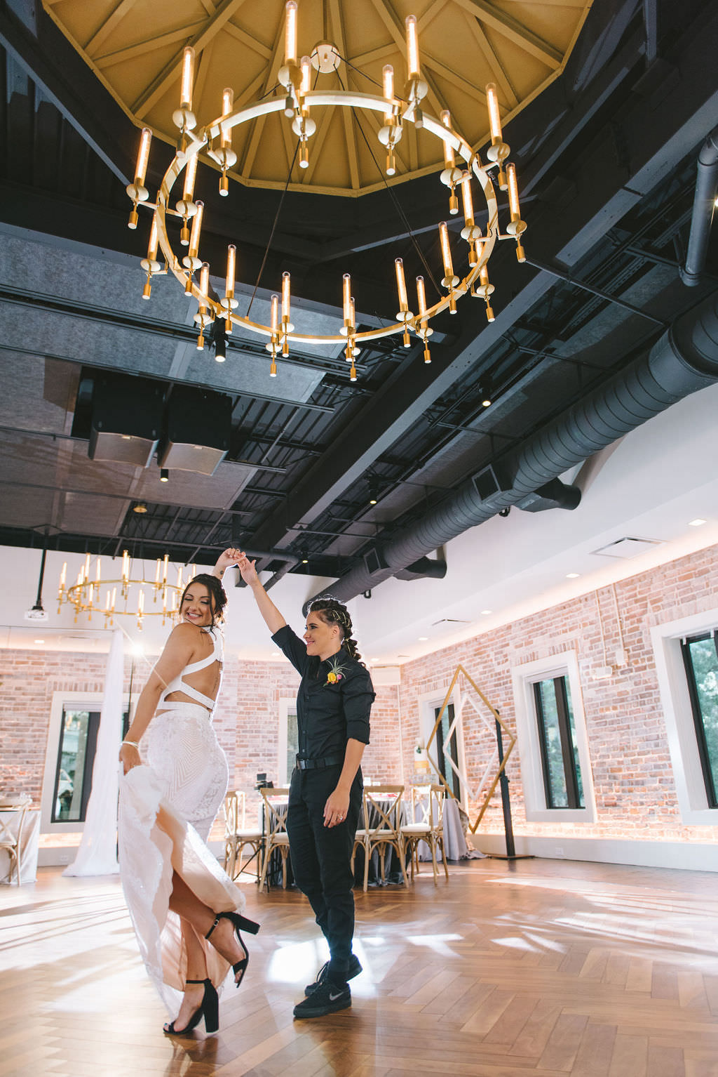 Florida Lesbian Gay Dancing Wedding Portrait in Modern Red Brick Wall Unique Downtown St. Pete Wedding Venue Red Mesa Events   Tampa Bay Wedding Photographer Kera Photography   Sarasota Wedding Dress Shop Truly Forever Bridal