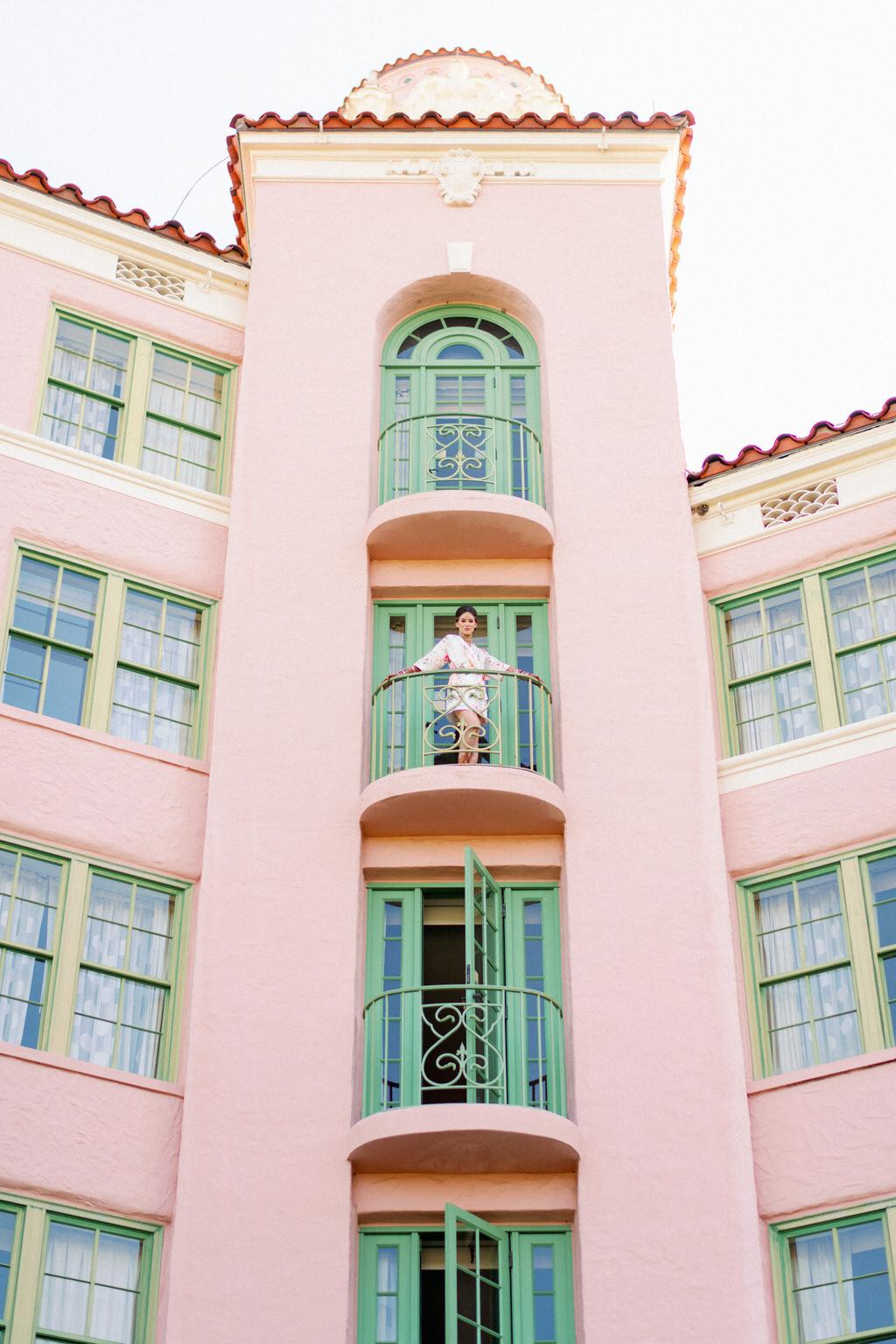 Bride on Balcony of Tropical, Florida Resort Waterfront Wedding Venue | The Vinoy Renaissance St. Petersburg Resort & Golf Club