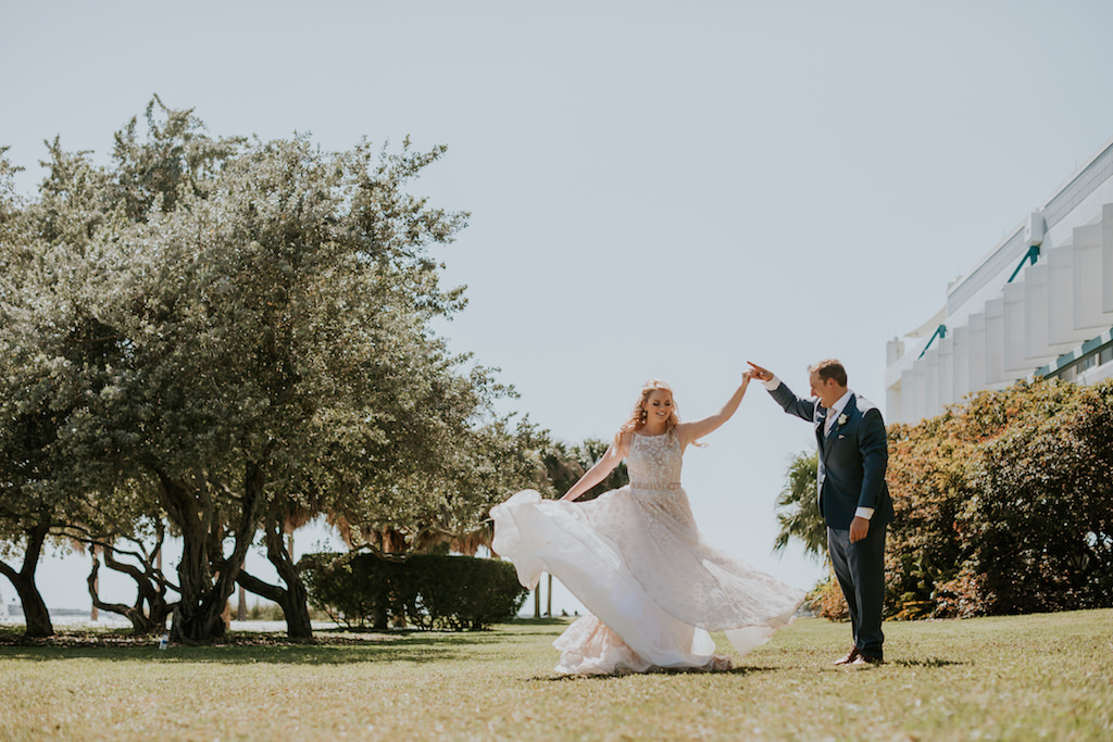 Fun St. Pete Bride and Groom Dancing Outside Wedding Portrait | Tampa Wedding Venue Station House
