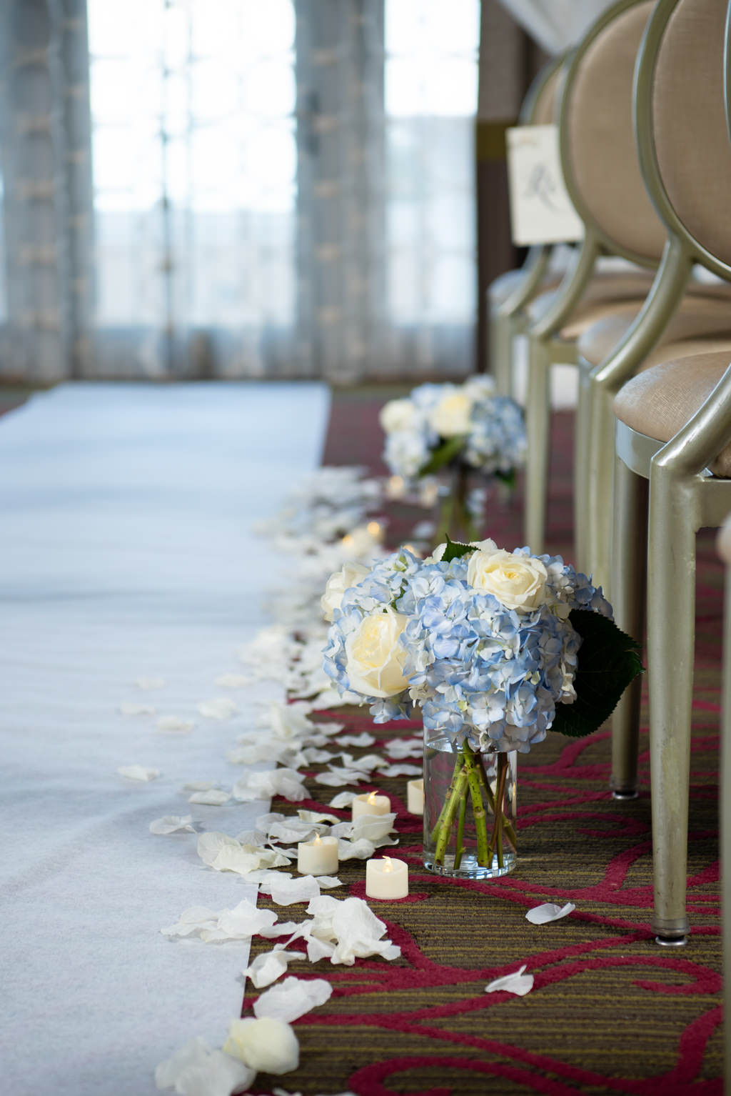 Florida Modern, Classic Wedding Ceremony Decor, Dusty Blue Hydrangeas and Ivory Roses Floral Arrangements in Vase, White Aisle Runner, Rose Petals, Candles   Tampa Bay Wedding Planner Coastal Coordinating