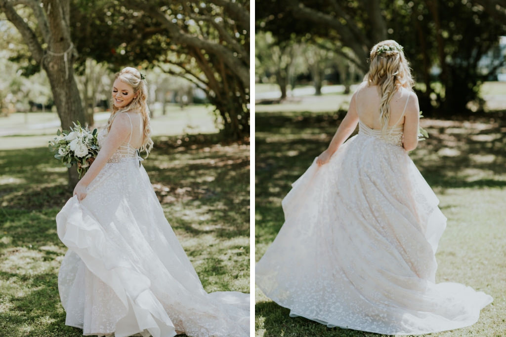 Florida Bride Beauty Wedding Portrait in Wtoo Watters Lace Ballgown Open Back Wedding Dress Holding Greenery and White Floral Bouquet and Greenery Floral Hair Piece Half Updo Style