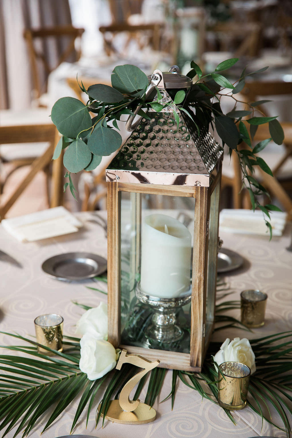Florida Rustic Elegant Wedding Reception Decor, Wooden and Silver Lantern with Candlestick, Palm Leaf, White Roses, Silver Dollar Eucalyptus and Gold Table Number