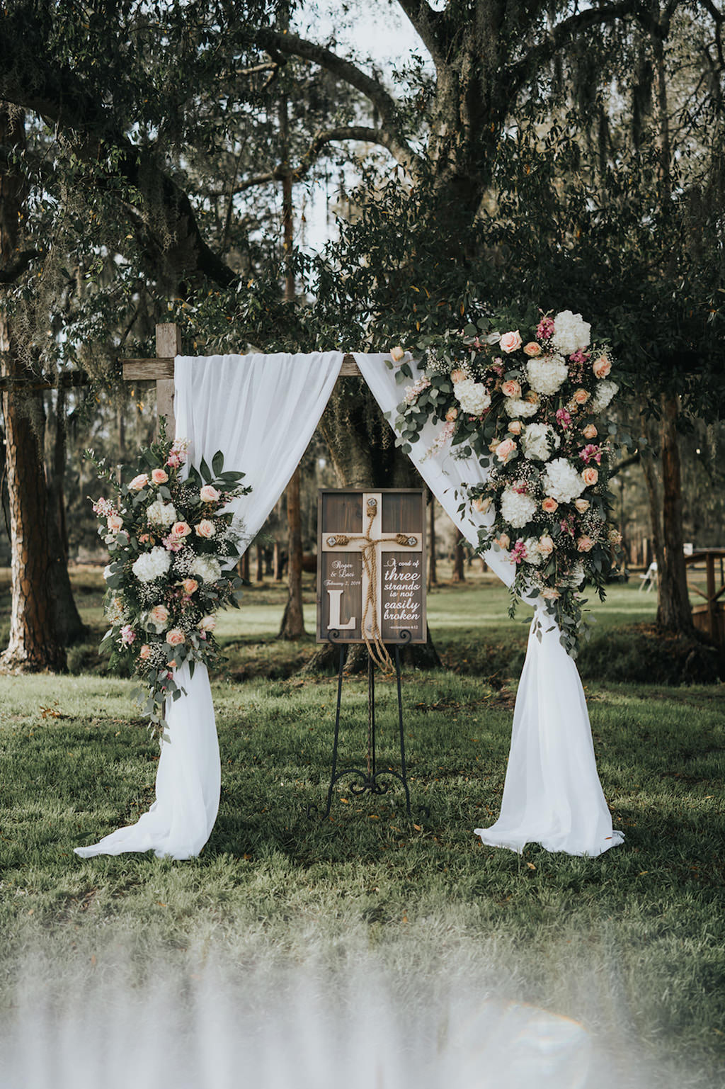 Rustic Chic Outdoor Wedding Ceremony Decor, Arch with White Linen Draping and White Hydrangeas, Blush Pink Roses and Greenery Floral Arrangement   Tampa Wedding Venue Rafter J Ranch   Wedding Planner Kelly Kennedy Weddings and Events