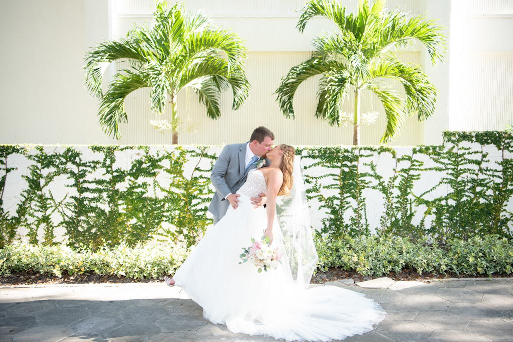 Modern Florida Bride and Groom Dip Kiss Outdoor Palm Treen Backdrop Wedding Portrait   Destination Wedding   Boutique Hotel Wedding Venue The Birchwood   Tampa Bay Wedding Planner Coastal Coordinating