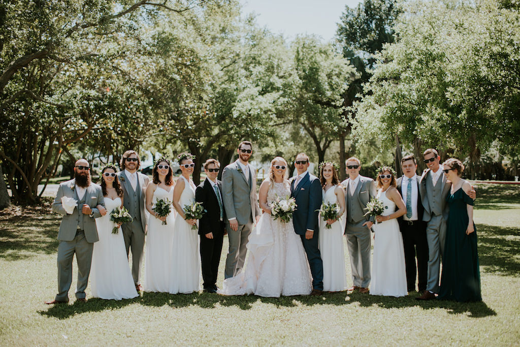 Fun Florida Bridal Party Portrait | Bridesmaids in White Mix and Match Dresses, Groomsmen in Gray Suits Wedding Party in Sunglasses Wedding Portrait