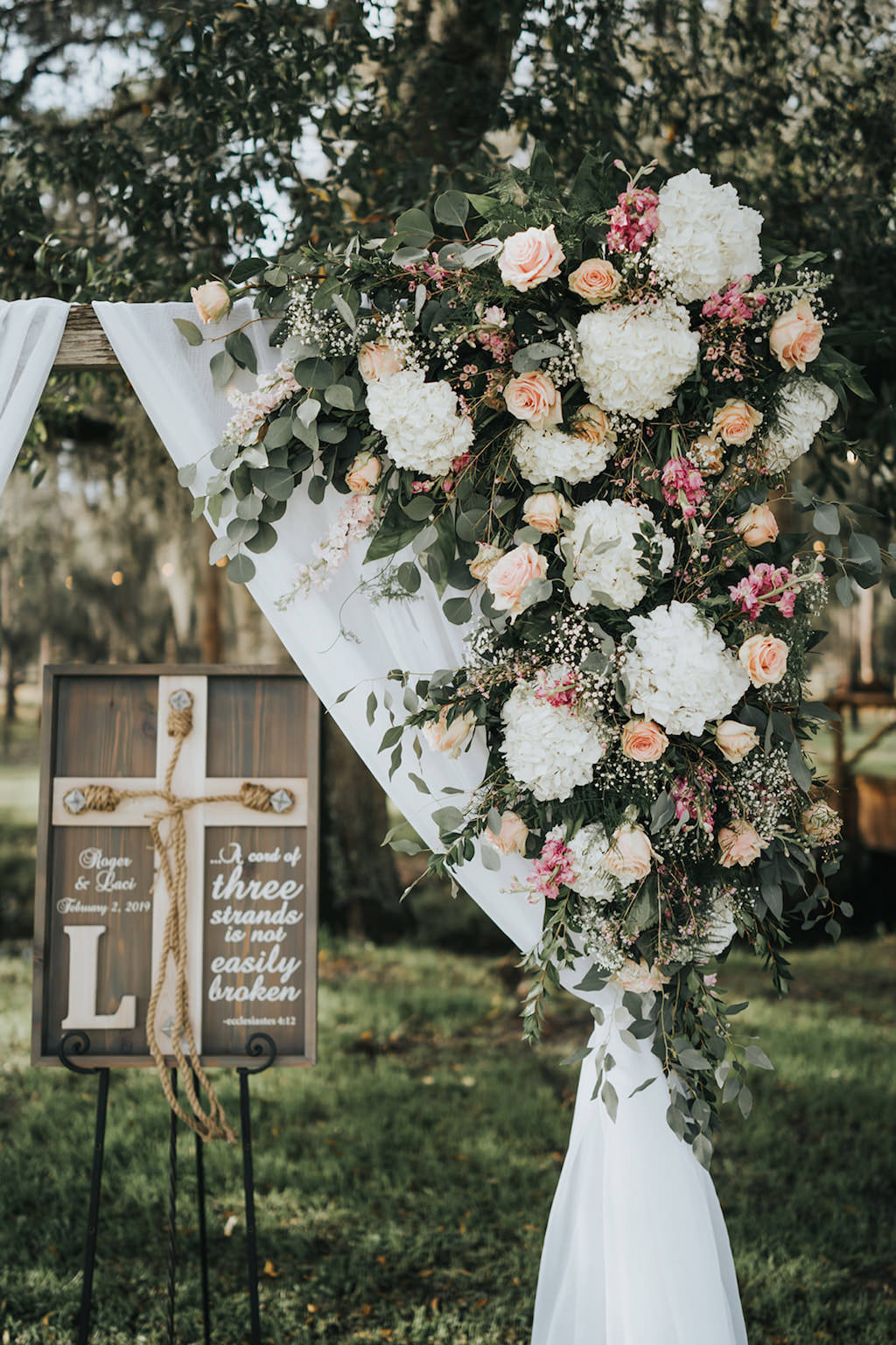 INSTAGRAM Rustic Chic Wedding Ceremony Decor, Arch with White Linen Draping, White Hydrangeas, Blush Pink Roses and Greenery Floral Arrangement   Tampa Wedding Planner Kelly Kennedy Weddings and Events