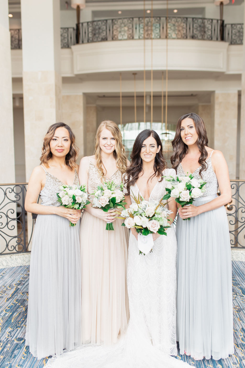 Classic Bride and Bridesmaids in Mix and Match BHLDN Gray and Nude Floor Length Flowy Dresses with Organic Ivory Roses and Greenery Floral Bouquets   Tampa Bay Wedding Hair and Makeup Femme Akoi Beauty Studio