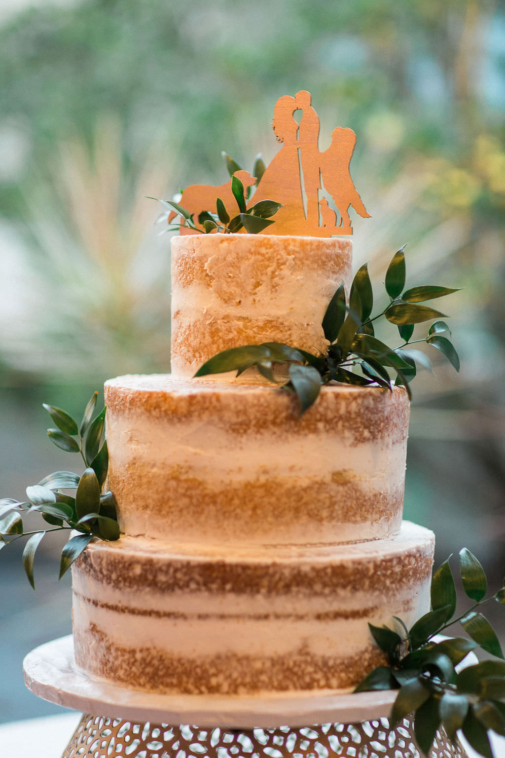 Rustic Semi Naked Three Tier Wedding Cake Decorated with Eucalyptus and Custom Wooden Cake Topper