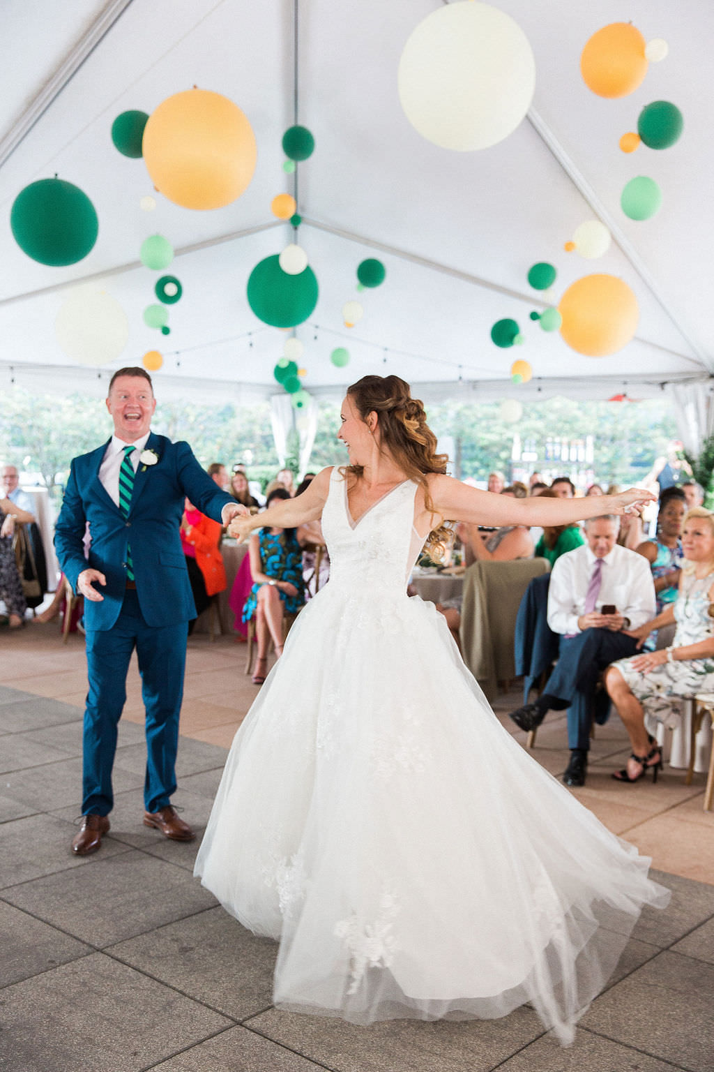 Rustic Elegant Bride and Groom First Dance Wedding Portrait, Whimsical Yellow, Green and White Hanging Balloon Tent Wedding Reception Decor | South Tampa Wedding Venue The Epicurean Hotel | Tampa Wedding DJ Grant Hemond and Associates