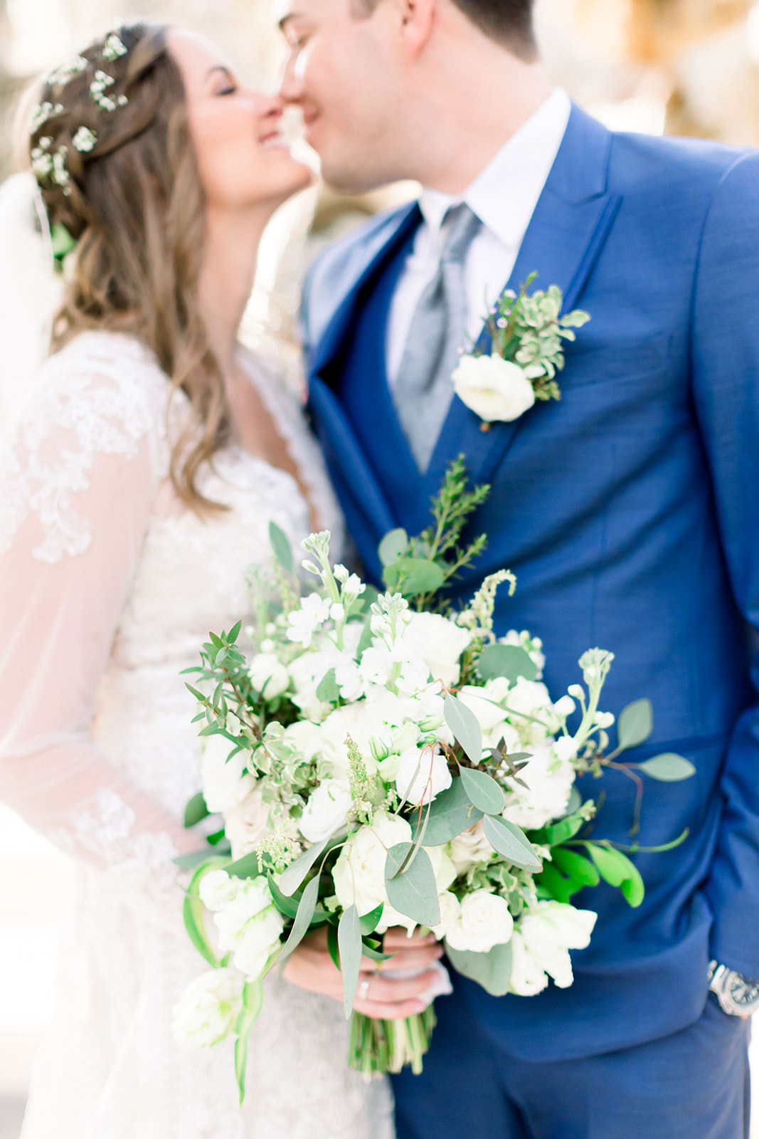 Elegant Tampa Bay Bride and Groom with White Floral Bouquet with Mix Stems, Eucalyptus Leafs, and Greenery | Tampa Bay Wedding Photographers Shauna and Jordon Photography