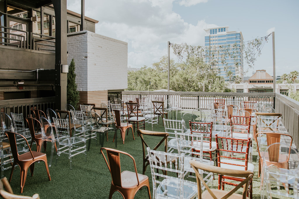 Rustic Elegant Rooftop Wedding Reception Decor, Mix and Match Chairs, Acrylic Ghost, Chiavari Chairs, Wooden Crossback Chairs, Copper Metal Chairs, Mahogany Chiavari Chairs, String Light with Hanging Greenery | Downtown St. Pete Wedding Ceremony Rooftop Venue Station House | Wedding Planner UNIQUE Weddings + Events