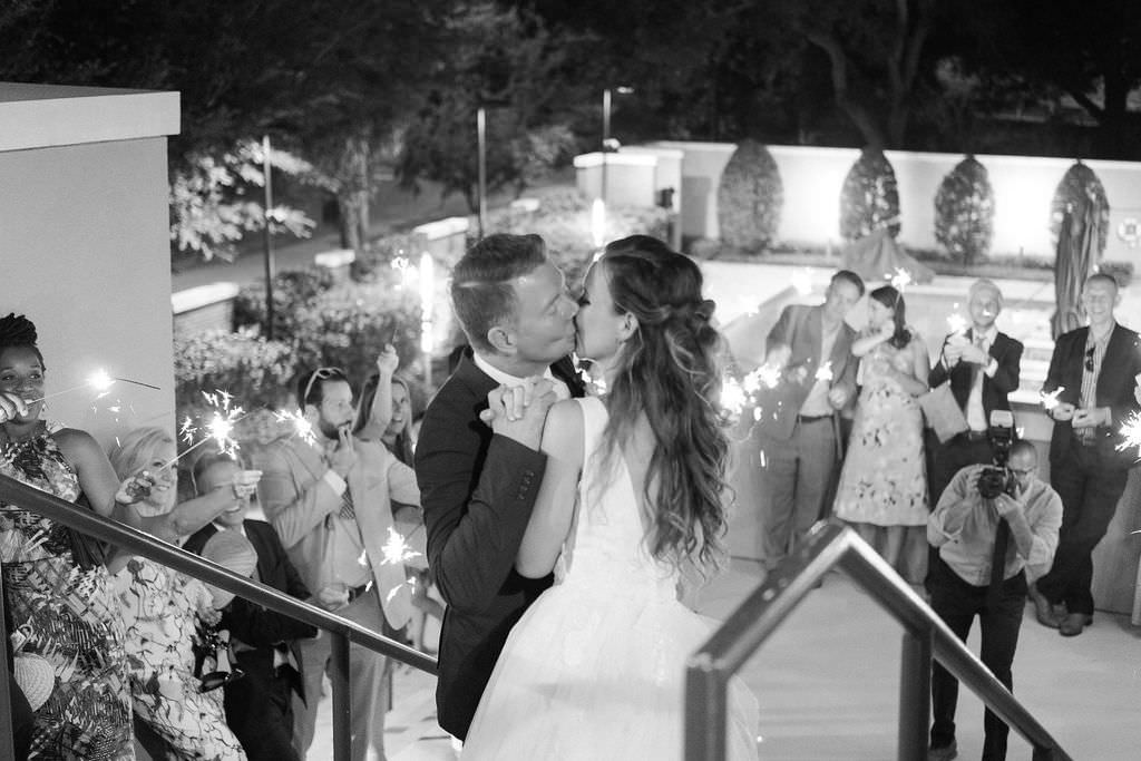 Classic Intimate Bride and Groom Outdoor Courtyard Black and White Wedding Exit Portrait