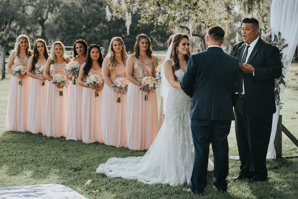 Rustic Chic Bride and Groom Exchanging Vows Under Trees Wedding Ceremony Portrait, Bridesmaids in Matching Blush Pink Sequin Bodice Dresses   Tampa Wedding Venue Rafter J Ranch