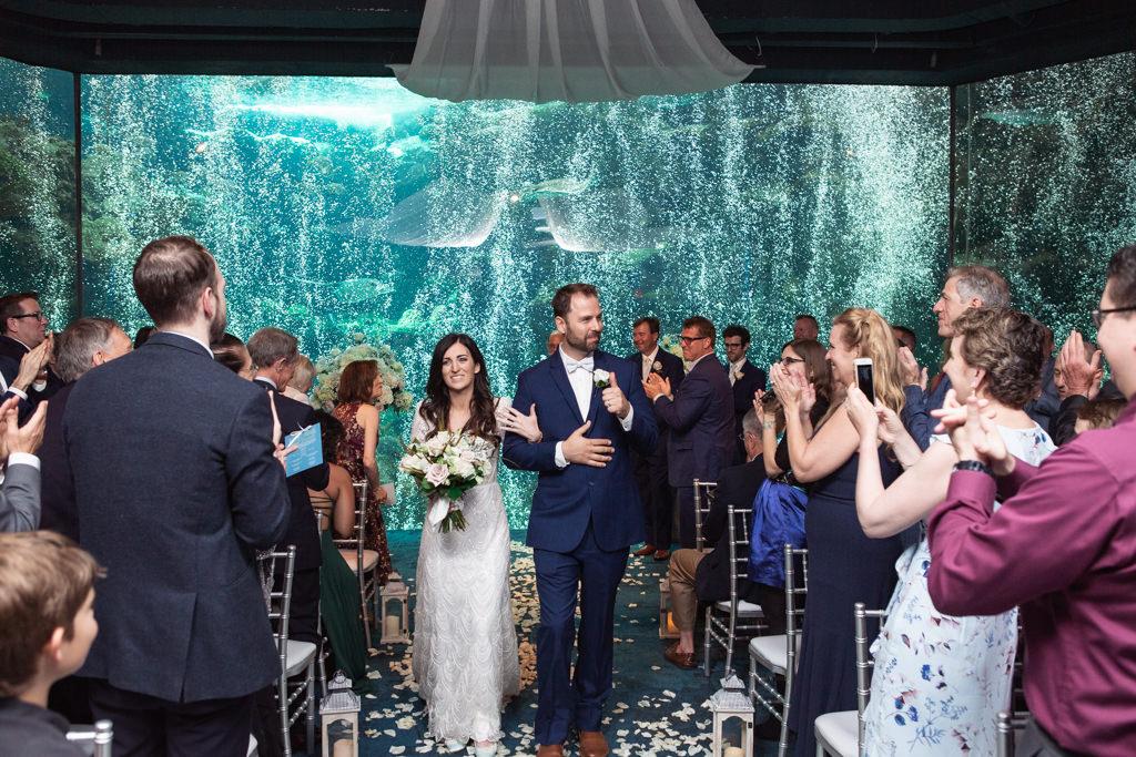Bride and Groom Wedding Ceremony Recessional Portrait at Unique Downtown Tampa Venue The Florida Aquarium