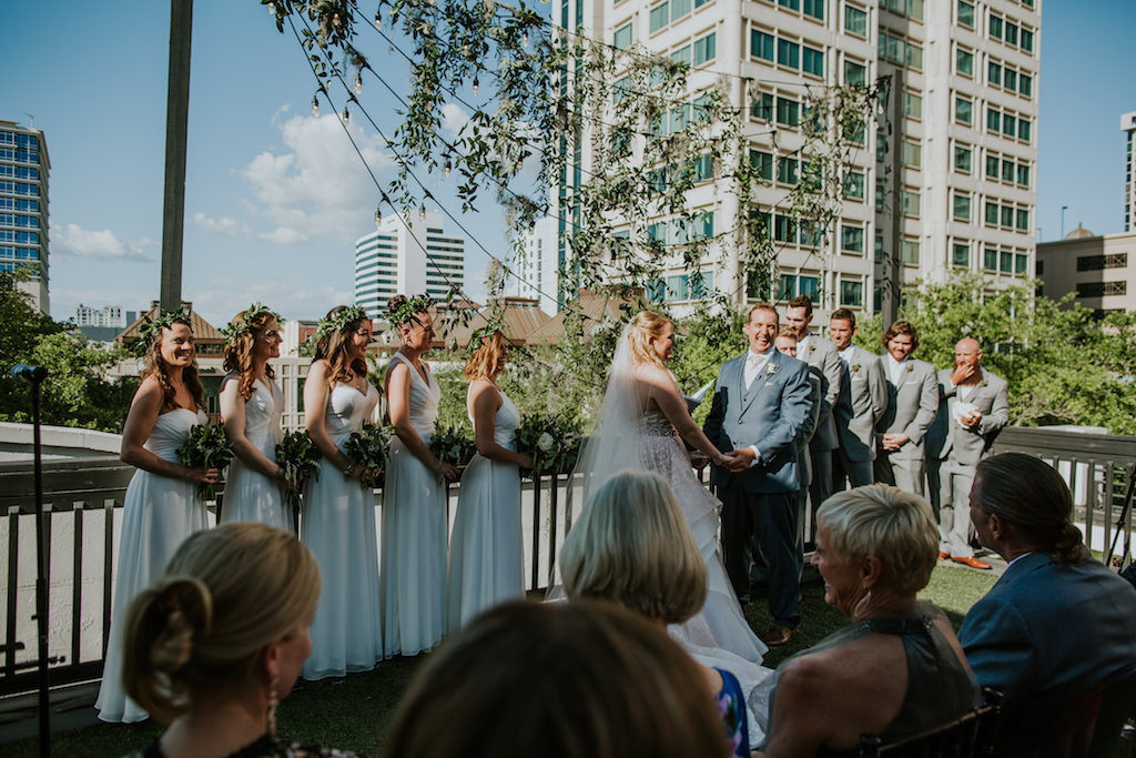 Outdoor Florida Rooftop Wedding Ceremony Bride and Groom Exchanging Vows Wedding Portrait | Downtown St. Pete Wedding Ceremony Rooftop Venue Station House