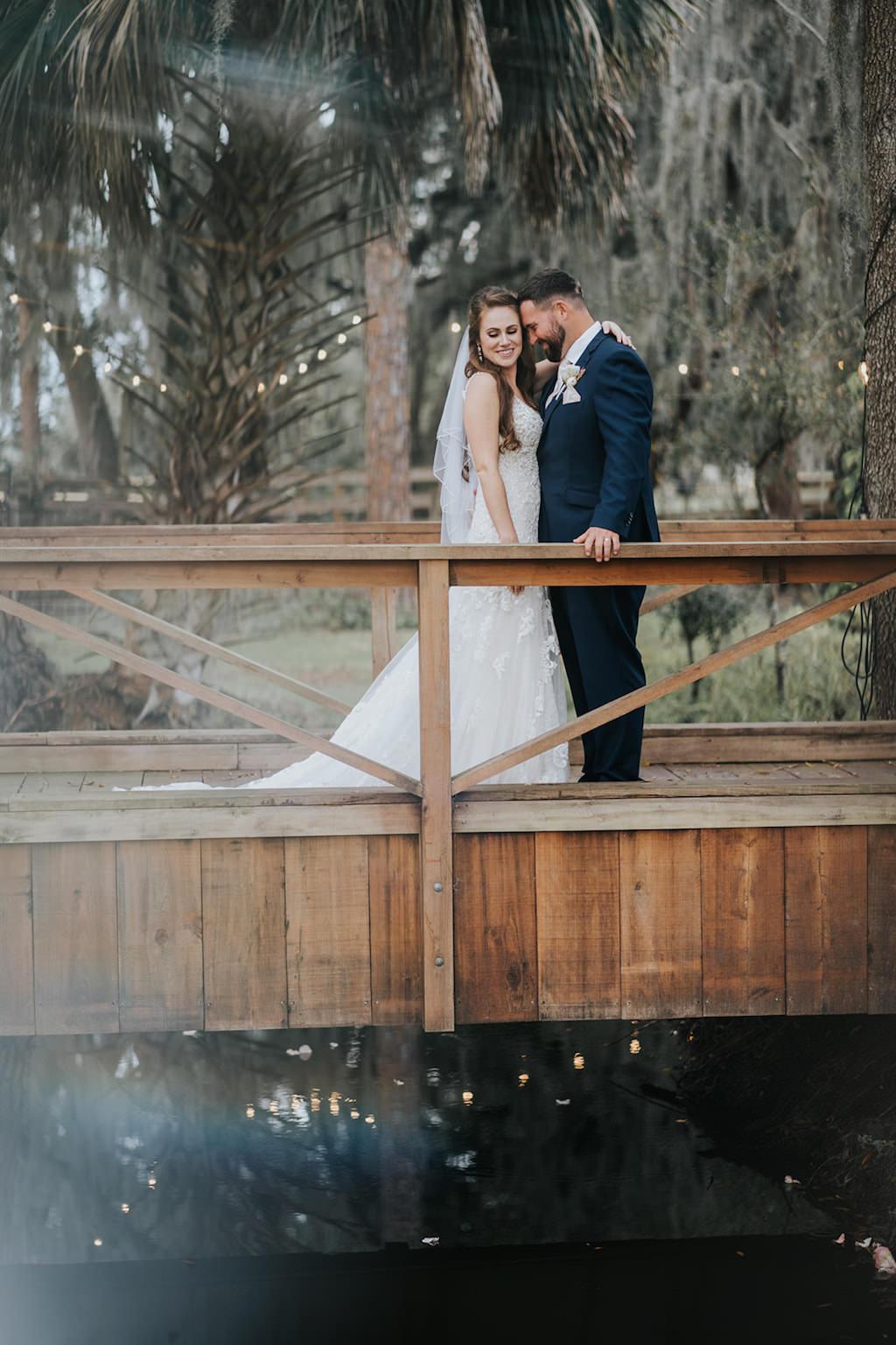 Romantic Florida Bride and Groom on Wooden Bridge Wedding Portrait   Tampa Wedding Venue Rafter J Ranch