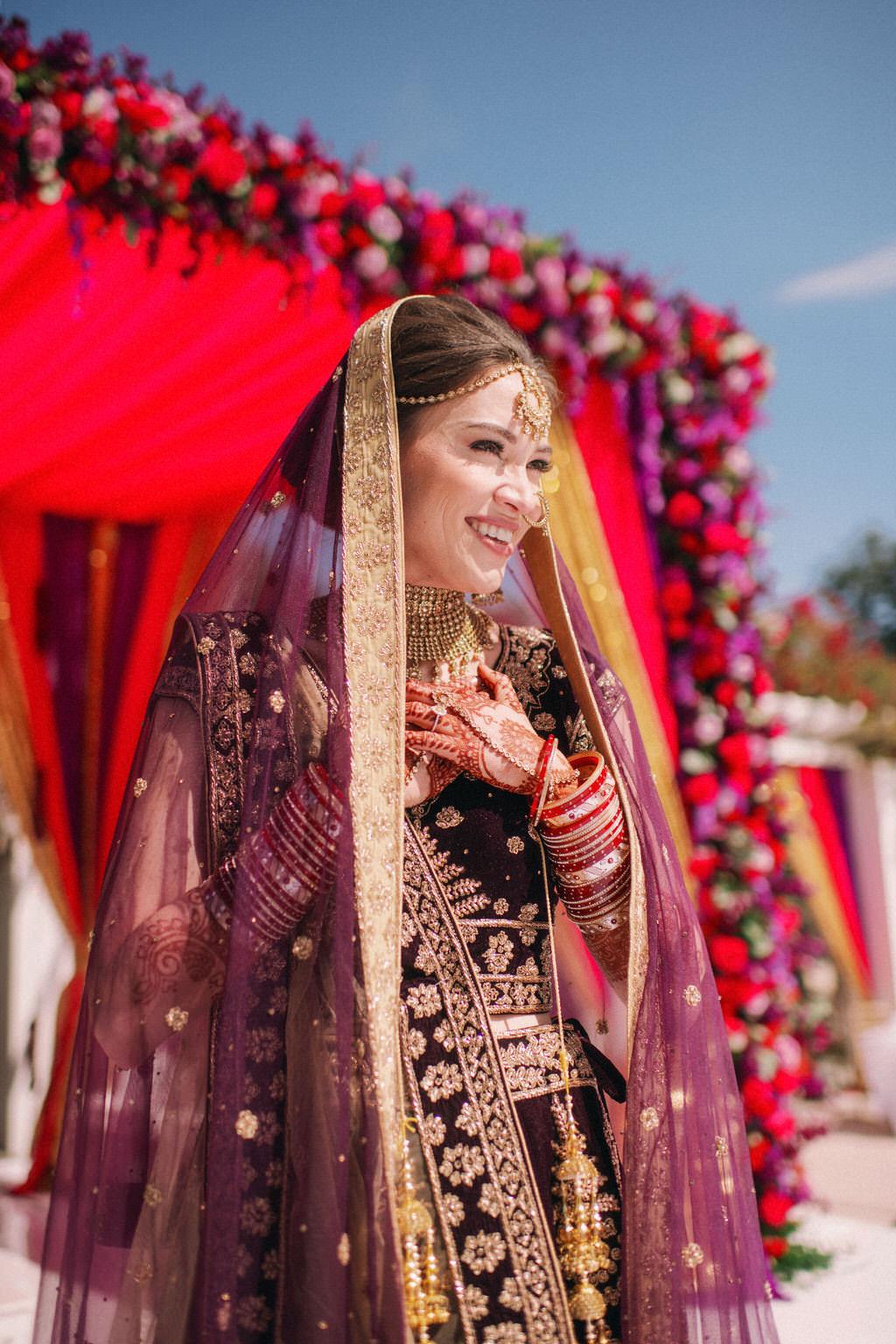 Elegant Luxurious Traditional Indian Bride in Custom Purple Velvet, Black and Gold Lehenga, Extravagant Gold Bridal Jewelry Beauty Wedding Portrait | Tampa Bay Bridal Hair and Makeup Artist Michele Renee The Studio
