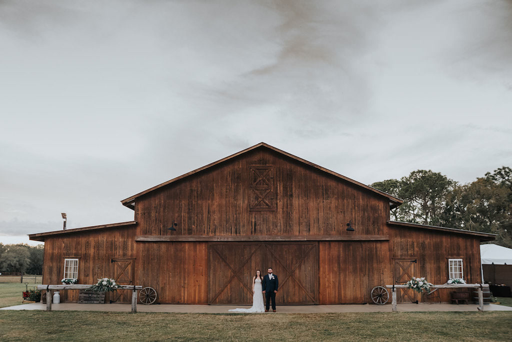 Florida Bride and Groom Outdoor Barn Wedding Portrait | Tampa Rustic Wedding Venue Rafter J Ranch | Tampa Wedding Planner Kelly Kennedy Weddings and Events