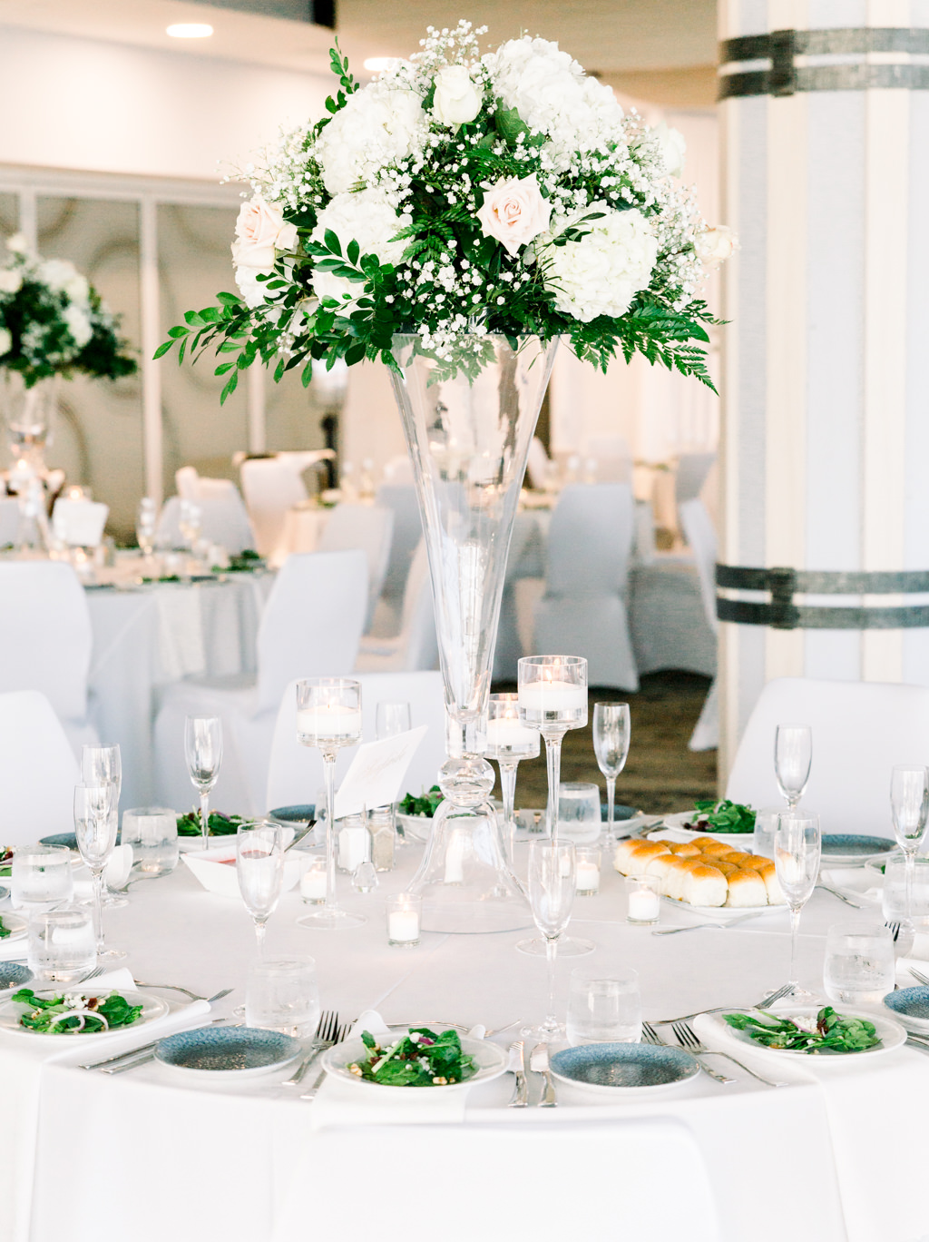 Classic Elegant Wedding Reception Decor, Round Tables with White Tablecloths and Linens, Tall Glass Cylinder Vase with White Hydrangeas, Blush Pink Roses, Baby's Breath and Greenery Leaves Floral Centerpiece   Downtown Tampa Wedding Venue The Florida Aquarium
