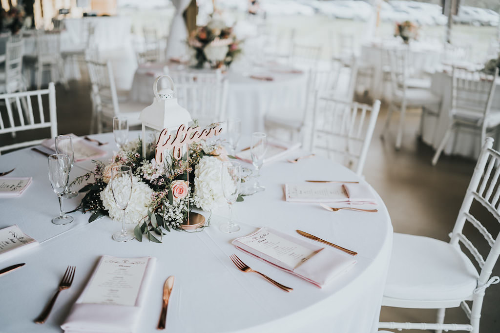 Rustic Chic Wedding Reception Decor, Round Tables with White Tablecloth, White Chiavari Chairs, Rose Gold Laser Cut Table Number, Blush Pink Linen Napkins, White Hydrangeas, Blush Pink Roses, Greenery Floral Low Centerpiece   Tampa Wedding Planner Kelly Kennedy Weddings and Events