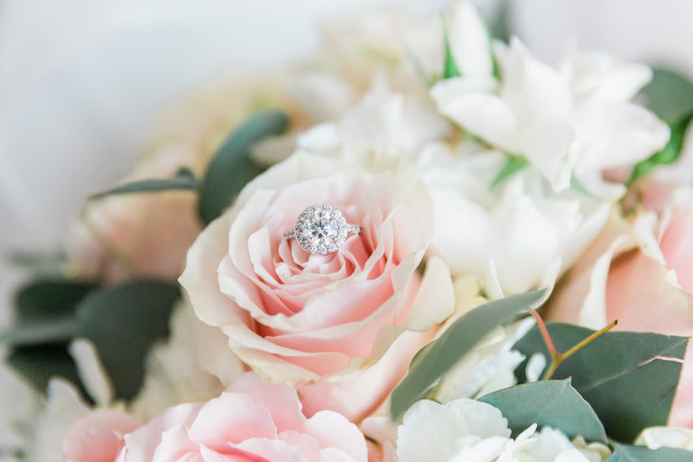 Solitaire Diamond Engagement Ring with Halo on Blush Pink Rose Wedding Floral Bouquet