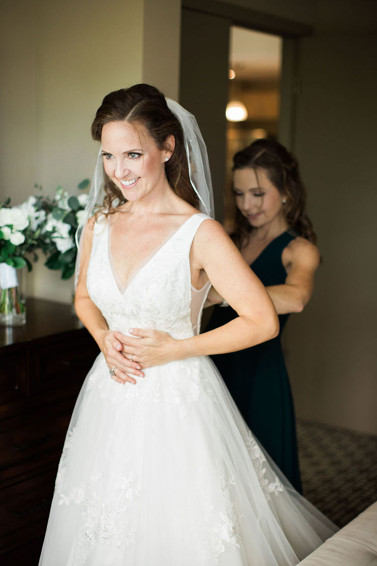 Classic Elegant Tampa Bay Bride Getting Ready Wedding Portrait in Deep V Neckline Floral Lace and Tulle A-Line Wedding Dress