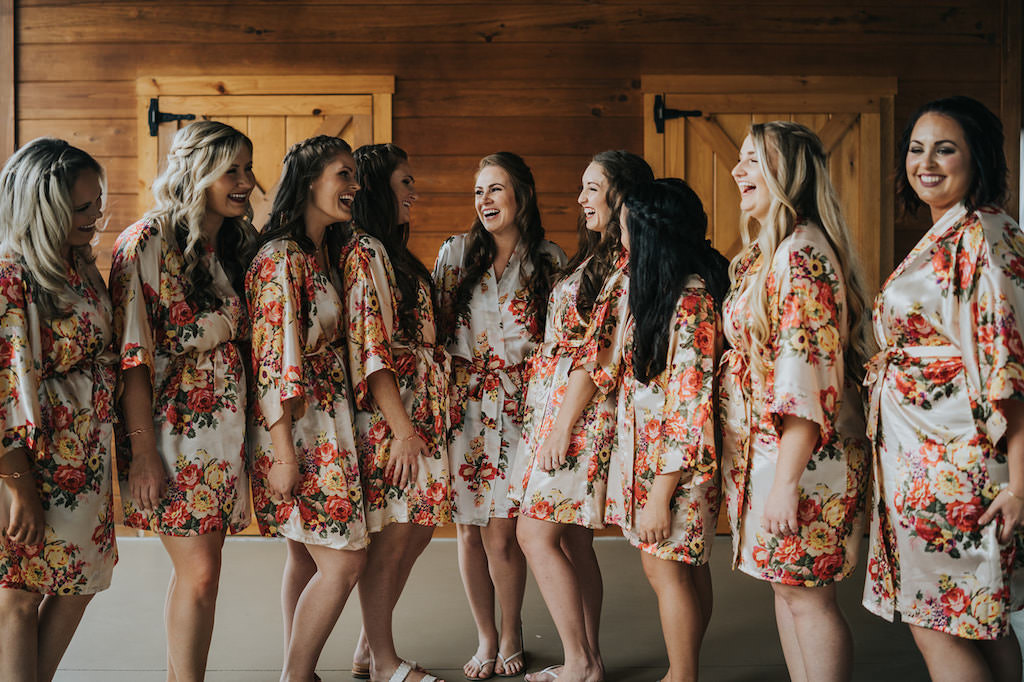 Tampa Bay Bride and Bridesmaids in Matching Floral Silk Robes Getting Ready Wedding Portrait