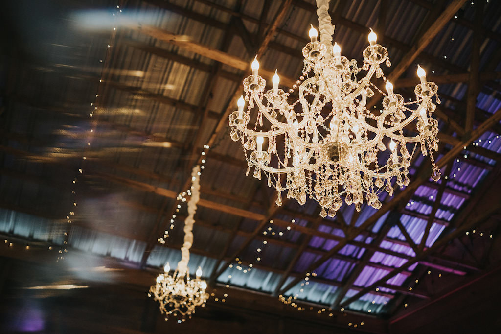 Elegant Crystal Chandeliers in Barn Wedding Venue Parrish Rafter J Ranch