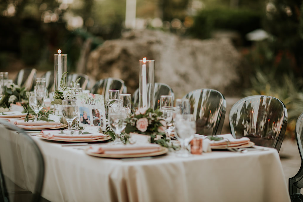 Romantic Modern Wedding Ceremony Decor, Long Table with Ivory Linen, Candlesticks, Greenery and Blush Pink Floral Table Runner, Clear Black Acrylic Chairs, Blush Pink Napkins | Tampa Bay Wedding Planner UNIQUE Weddings + Events | Wedding Rentals A Chair Affair | Wedding Linens Over the Top Rental Linens