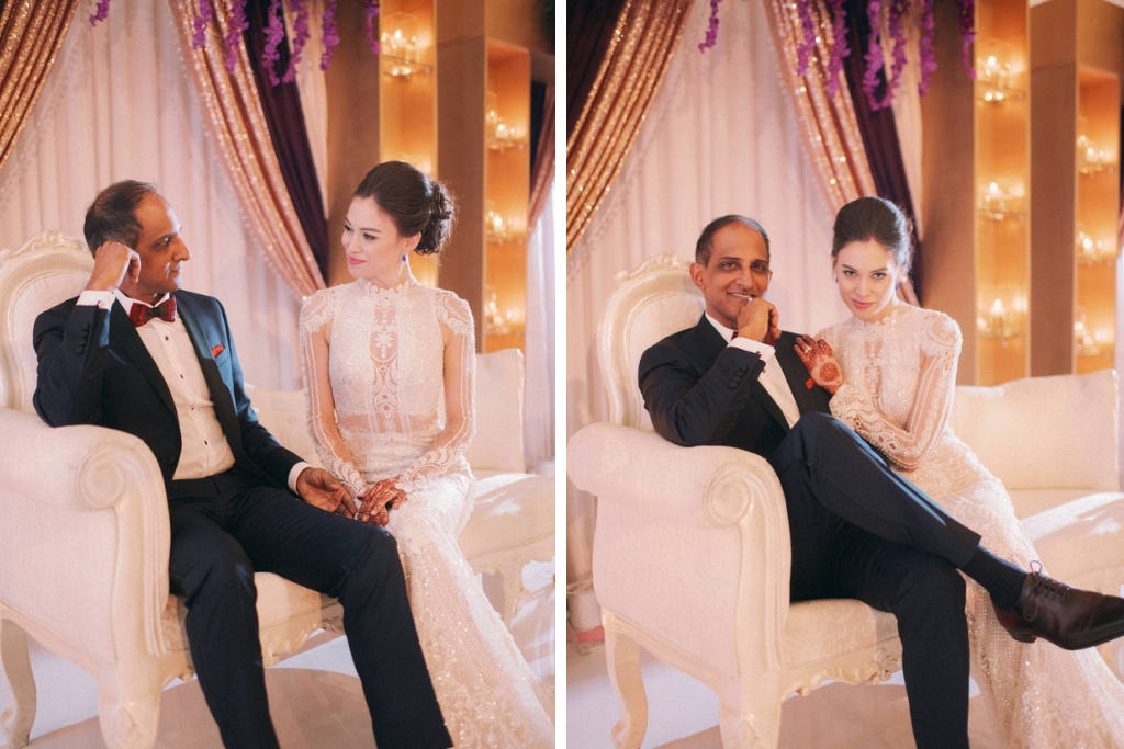 Indian Bride and Groom Wedding Portrait on Elegant White Loveseat with White, Purple and Gold Draping Backdrop | Tampa Wedding Hair and Makeup Artist Michele Renee the Studio | Tampa Couture Wedding Dress Boutique Isabel O'Neil Bridal Collection