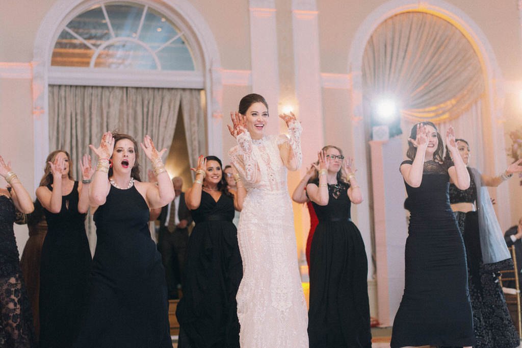 Florida Bride and Wedding Party Performing Traditional Bollywood Dance | Tampa Couture Wedding Dress Boutique Isabel O'Neil Bridal Collection