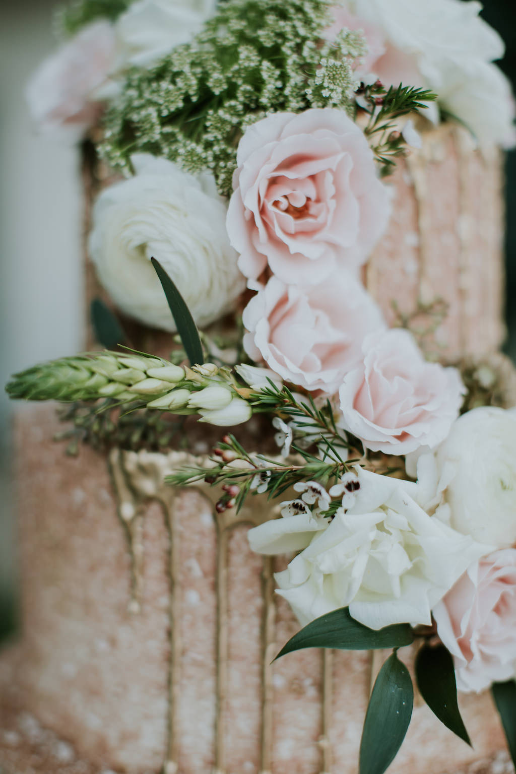 Whimsical Blush Pink with Gold Drip Wedding Cake and Cascading Blush Pink and White Roses with Greenery Accents Wedding Cake | St. Pete Wedding Cake Bakery The Artistic Whisk