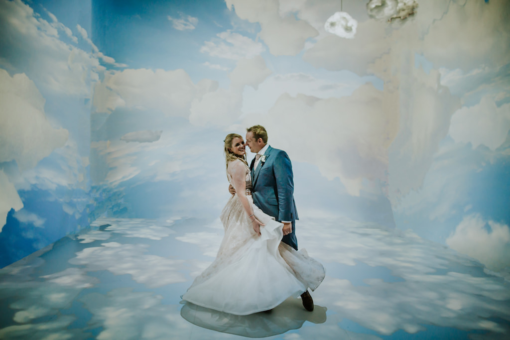 Whimsical Fun and Creative Bride and Groom Wedding Portrait in Artsy Cloud Room | Downtown St. Pete Wedding Venue Salvador Dali Museum