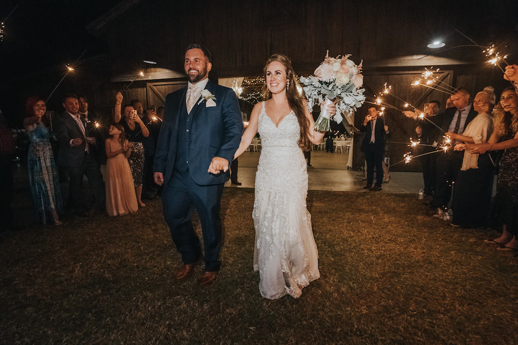 Rustic Chic Florida Bride and Groom Wedding Reception Sparkler Exit   Tampa Wedding Venue Rafter J Ranch   Wedding Planner Kelly Kennedy Weddings and Events
