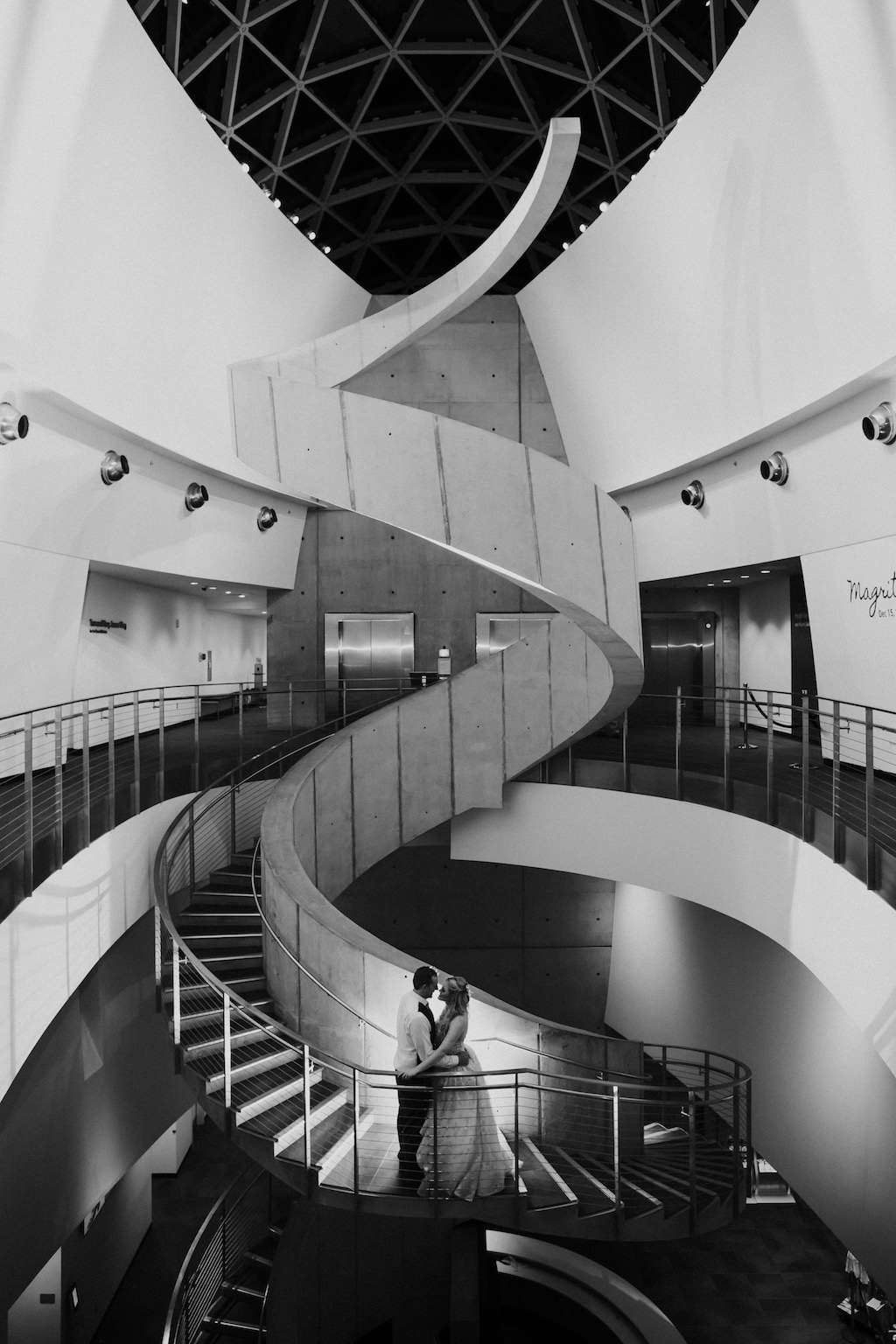 Black and White Tampa Bride and Groom Creative Wedding Portrait on Spiral Staircase | Downtown St. Pete Wedding Venue Salvador Dali Museum
