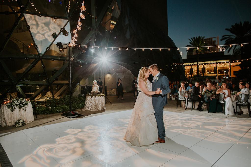 Romantic Bride and Groom Outdoor First Dance Wedding Reception Portrait Under Cafe Lights | Tampa Bay Wedding Planner UNIQUE Weddings + Events | Downtown St. Pete Wedding Venue Salvador Dali Museum