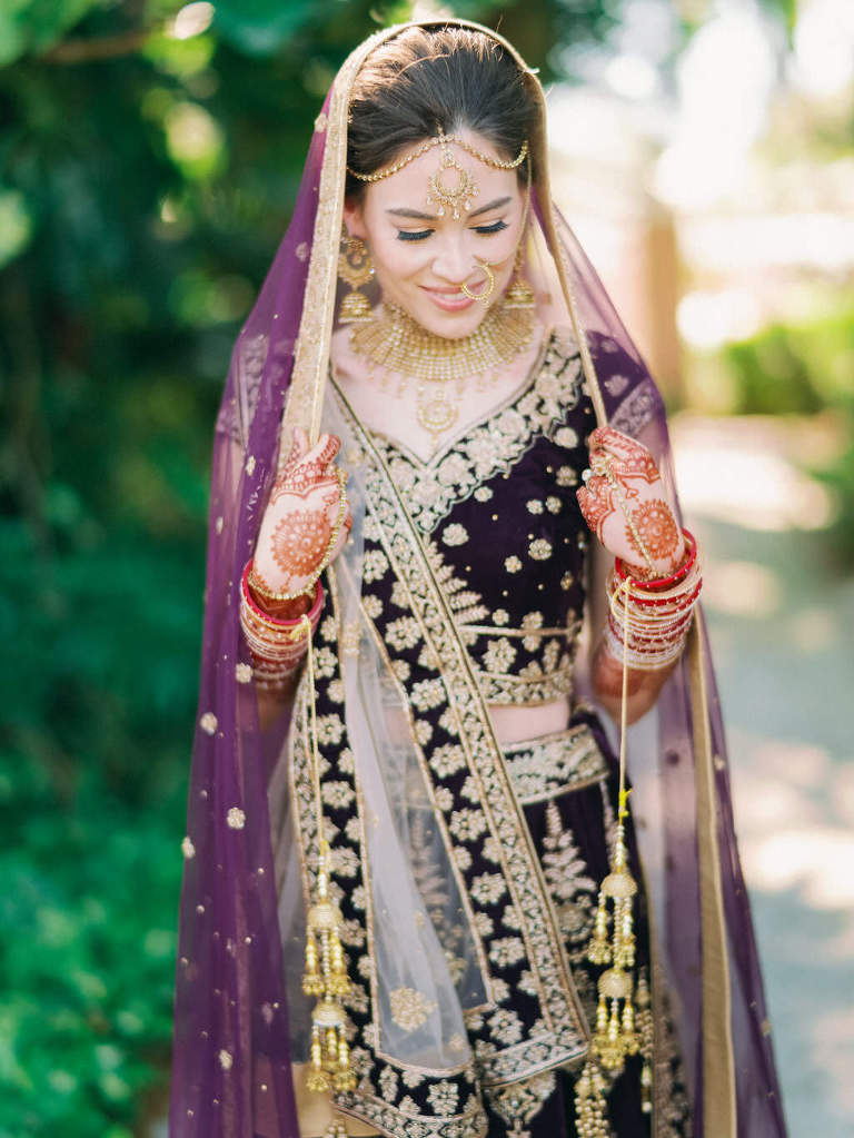 Traditional Hindu, Indian Colorful Bride, Beauty Wedding Portrait, Extravagant Gold Bridal Jewelry, Bridal Mehndi Henna Tattoo, Purple and Gold with Rhinestones Indian Bridal Veil, Custom Purple Velvet Lehenga | Tampa Bay Bridal Hair and Makeup Artist Michele Renee The Studio