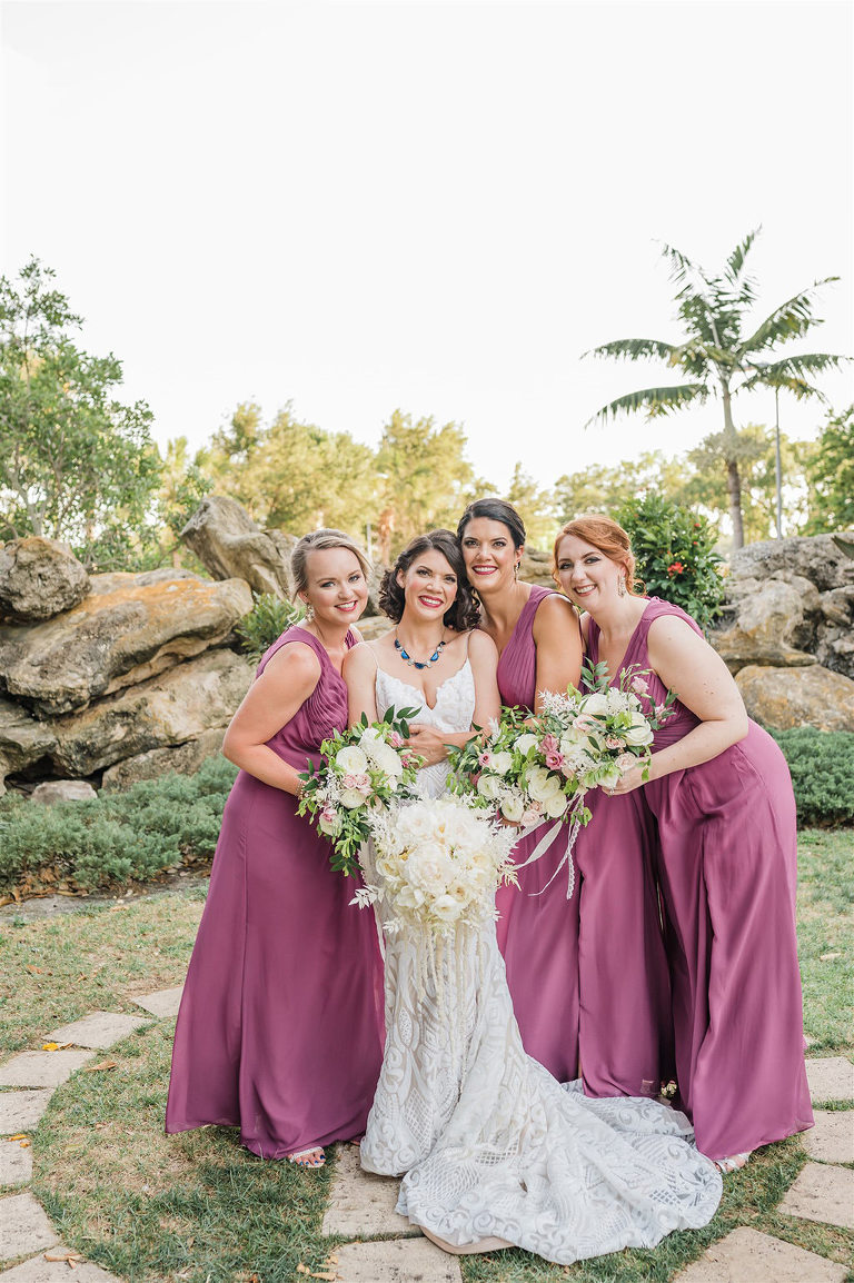 Elegant Classic Bridal Party Outdoor Garden Wedding Portrait, Bridesmaids in Matching Magenta Dresses with Whimsy Ivory, White, Blush Pink and Greenery Floral Bouquets | Tampa Bay Wedding Planner and Florist John Campbell Weddings | St. Petersburg Unique Wedding Venue Salvador Dali Museum
